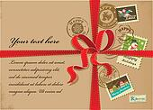Christmas gift with red ribbon and vintage postage stamps