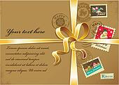 Christmas gift with gold ribbon and vintage postage stamps