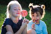 children with lollipop candy