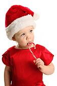 Adorable young girl eating a candy cane