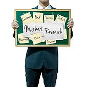 Business man holding board on the background, Market Research