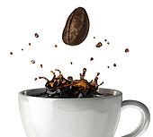 Coffee crown splash in mug. Close up view, with a bean falling d