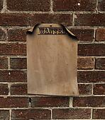 wanted poster on a brick wall