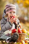 Kid eating red apple