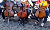 Young people play cello in street music day