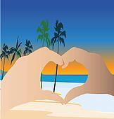 Hands doing a heart on the beach