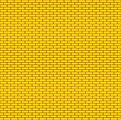 Yellow brick wall. Seamless background