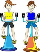 Two fitness girls exercising on indoor bikes