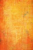 Old canvas: Abstract textured background with red and orange patterns on yellow backdrop