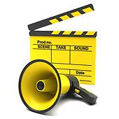 Yellow movie clapper and megaphone