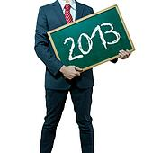 Business man holding board on the background, Happy new year 2013
