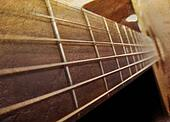 Old Brown Acoustic Guitar Closeup