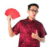 Shocked Asian Chinese man holding many red packets