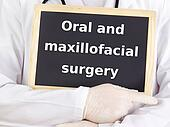 Doctor shows information: oral and maxillofacial surgery