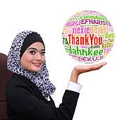 young muslim business woman showing Thank you word globe in many language, isolated on white background