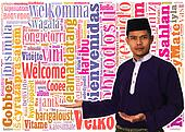 Asian muslim male with traditional Malay costume in present Welcome concept word in many languages of the world.