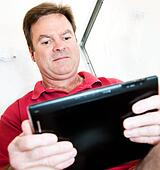 Man in Bathroom with Tablet PC