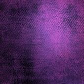 Abstract purple background or paper with bright center spotlight and dark border frame with grunge background texture