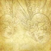 Vintage golden background with Venetian masks