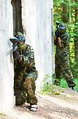 paintball players team aiming markers