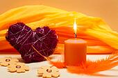 romantic orange background with candle and heart
