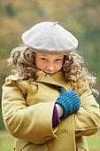 Girl wrapping in winter coat