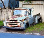 Rusted blue vintage pickup truck