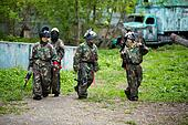 """MOSCOW - MAY 14: Boys in camouflage uniforms with markers in their hands go on ground for paintball at recreation complex """"Fishing Village"""", May 14, 2011, Moscow, Russia."""