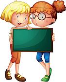 Two girls holding a green board
