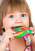 Baby girl eating a sticky lollipop
