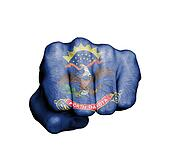 United states, fist with the flag of North Dakota