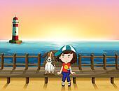 A boy, a dog and a light house