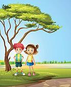 A girl and a boy near a big tree