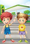 Two little boys near the gasoline station