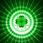 green shamrock in circles with rays