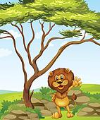 A lion standing beside a big tree