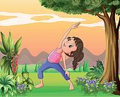 A lady exercising near a big tree