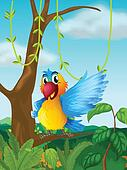 A parrot at a branch of a big tree