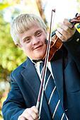Cute handicapped boy playing violin.