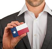 Businessman is holding a business card, Texas