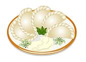 dumplings with sour cream on the plate
