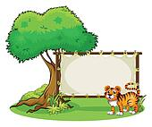 A tiger beside a wooden frame near a big tree
