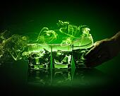 Three glasses of green absinth with ice cubes