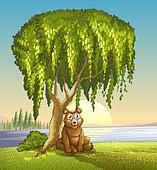 A bear under a big tree