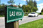 LAS VEGAS sign against sportive car on the rural road