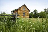 Early settlers' log cabin on the prairie