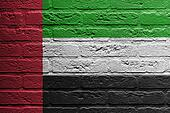 Brick wall with a painting of a flag, The United Arab Emirates