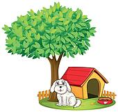 A white puppy beside a doghouse under a big tree