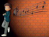 A boy standing near the wall with musical notes