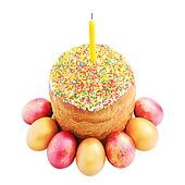Easter cake with sugar glaze, painted eggs and candle isolated